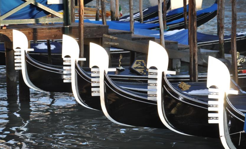 Gondolas lined up in the canals of Venice